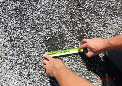 Inspector Analyzing Damaged Gravel By Hail Weather
