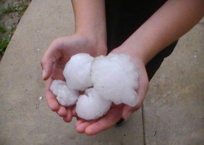 Woman Holding Big Hailstones In Her Hands