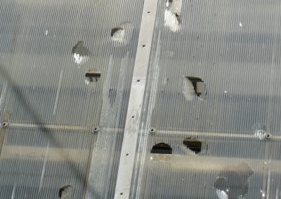 Hail Damage To Broken Roof Plastic