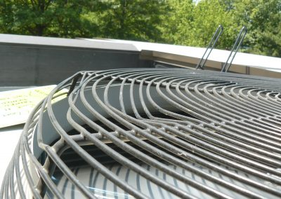 Metal Grill Roof Element Bent By Hailstorm