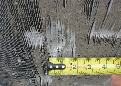 Roofing Expert Measuring Damaged HVAC