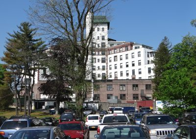 View Of Parking Lot And Building With Green Roof