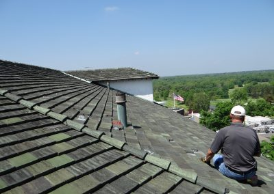 Roof Inspector Performing A Tile Roof Analysis