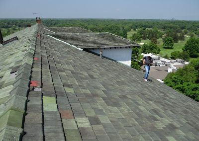 Man Performing Tile Roof Inspection
