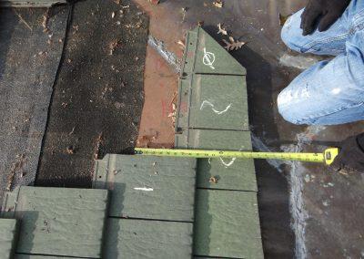 Inspector Measuring White Marked Defective Green Tiles