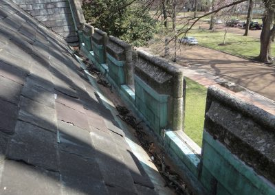 Stone Barrier At Edge Of Tile Roof