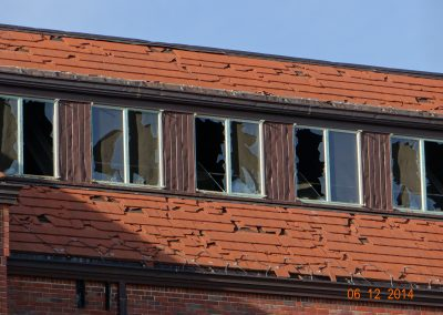 Building With Broken Windows And Tiles