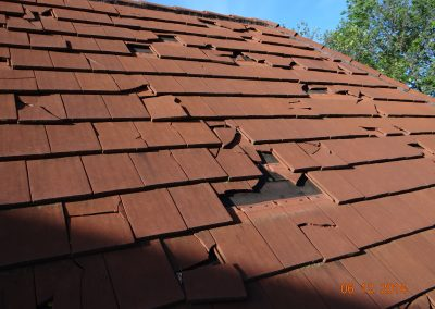 Roof With Cracked And Missing Flat Tiles