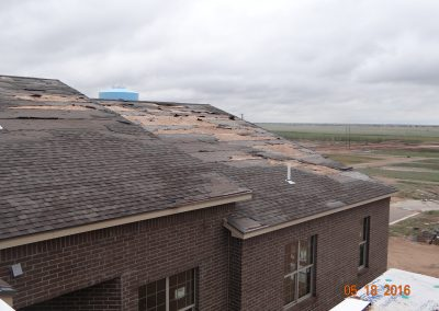 Shingles Roof With Missing Parts After Extreme Weather