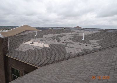 Damaged Roof Made Of Shingles