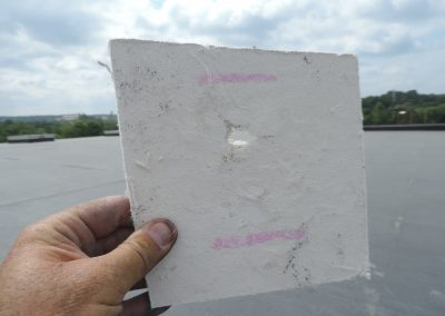Hail Damage To A White Roof Material