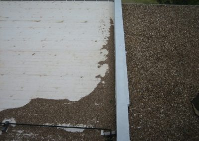 Gravel Scoured Over The Other Roof By Strong Wind