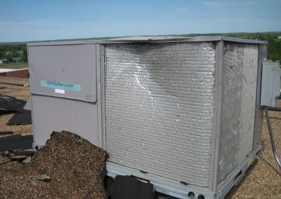 AC Unit And Gravel Roof Damaged By Extreme Weather