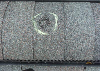 Damaged Ridge Vent On Shingle Roofing