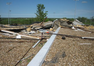 Wind Damage And Debris Over BUR Roof
